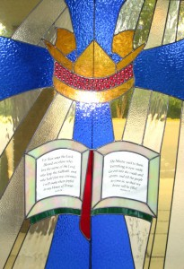 Cross and crown,with open bible.